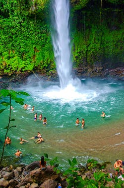 People swiming at La Fortuna Waterfall